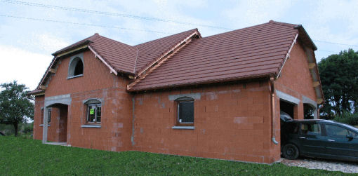 Maisons en l parement extrieur pour maison en bois d for Maison brique monomur
